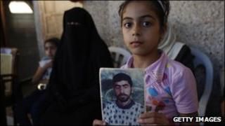 """A member of Palestinian prisoner Nasser Nazzal""""s family shows at a relative's house in the southern Gaza Strip town of Khan Younis"""