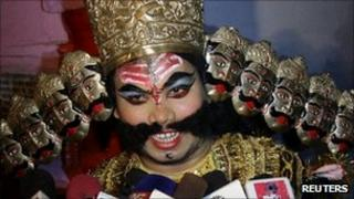 A man dressed up as the demon king Ravan in Allahabad on 23 September 2011