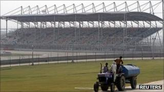 A tractor pulls a water tanker at the Buddh International Circuit, the venue for the first ever Indian Formula One race at Greater Noida,