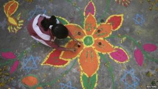 Girl drawing lotus flower