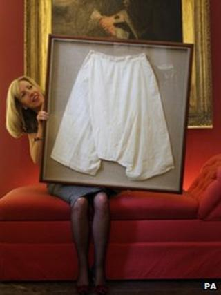 Kate Bain holds a pair of silk bloomers belonging to Queen Victoria