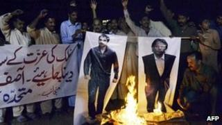 Pakistani protesters burn the photographs of former Pakistani cricketers Salman Butt and Mohmmad Asif during a protest in Multan on November 3, 2011.