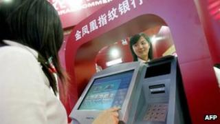 High-tech cash machines being exhibited at a trade fair in Beijing on 13 February 2007