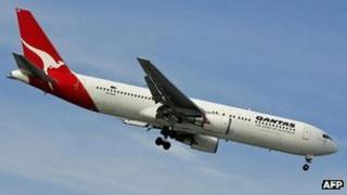 A Qantas flight comes in to land