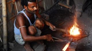 Blacksmith in Bihar melting down a pistol
