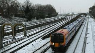 A train travelling on snow-covered tracks