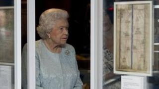The Queen looks at some exhibits at the