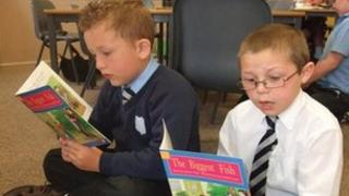 Primary pupils reading books