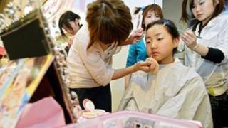 Girl having her make-up done