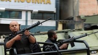 Paramilitary police commandos patrol a street of the Rocinha shantytown in Rio de Janeiro, Brazil, on 13 November 2011