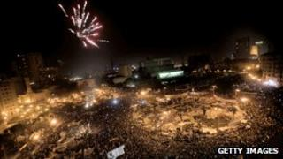 Protesters in Tahrir Square, Cairo, celebrate as Egyptian President Hosni Mubarak steps down, 11 February 2011