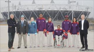 Jonathan Edwards (left) and Paul Deighton (right) with some Games Makers and officials in their new uniforms