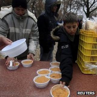 Poor Hungarians receiving food handouts in Budapest, 22 Nov 11