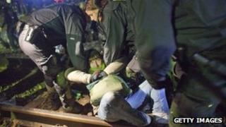 German police remove anti-nuclear waste protester from train tracks in Harlingen - 27 November 2011