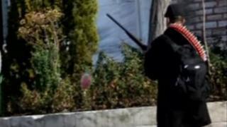 The man carrying a shotgun outside Topkapi Palace