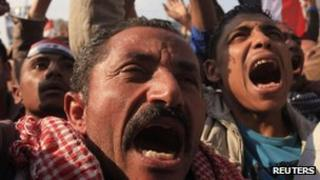 Protesters chant slogans during a demonstration against the Egyptian military council in Tahrir square in Cairo on Friday