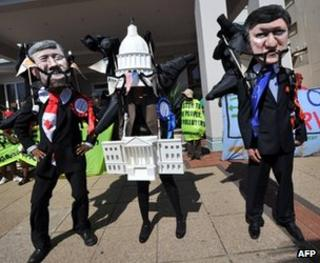 Environmental campaigners outside the climate talks, Durban (Image: AFP)