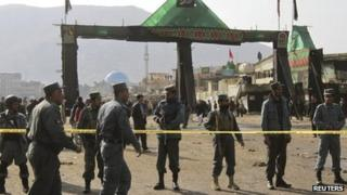 Afghan police keep watch after a suicide attack at a Shia Muslim gathering in Kabul