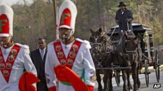 Members of Marching 100 process in front of Robert Champion's casket 30 November 2011