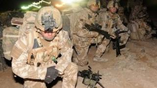 Members of the 1st Battalion The Royal Welsh wait as a helicopter lands as they prepare for Operation Moshtarak at Camp Bastion in Helmand Province on February 13, 2010,