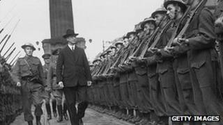 First Taoiseach of the Republic of Ireland Eamon de Valera inspects a guard of honour at O'Connell Street in Dublin