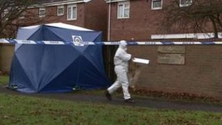 Scene of crime officer at the property in Wolverhampton