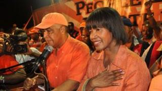 """Portia Simpson Miller (R) addresses supporters of the People""""s National Party (PNP) on election night, December 29, 2011 in Kingston"""