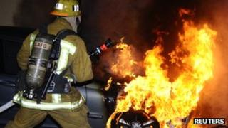 LA firefighter tackles arson attack on a car in North Hollywood, California, on 31 December 2011