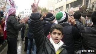 Demonstrators protest against Syria's President Bashar al-Assad after Friday prayers in Idlib, 6 January 2012