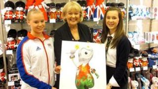 Cheryl Gillan with Olympic hopeful, gymnast Lizzie Beddoe and design competition winner Emma Davies