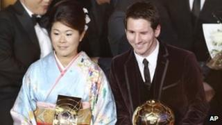 Japanese captain Homare Sawa (seen with Lionel Messi) at the FIFA Ballon d'Or in Zurich on 9 January, 2012