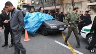 Iranian security forces at the scene of Mostafa Ahmadi-Roshan's killing