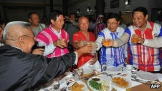 General Mutu Saipo (C), a representative of the rebel Karen National Union (KNU) toasting with Burmese government officials on the eve of peace talks in Hpa-An, the main city of the country's eastern Karen state on January 11, 2012