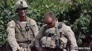 Still from video allegedly showing US Marines urinating on Taliban corpses