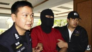 Thai police lead a detained a suspect with alleged links to Hezbollah