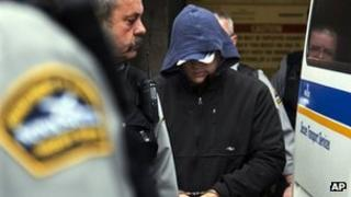 Jeffrey Paul Delisle is escorted from provincial court in Halifax, Nova Scotia, Canada on 17 January 2012