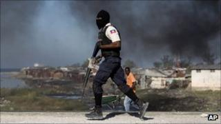 Masked Haitian policeman with rifle in Port-au-Prince, 24 December 2011