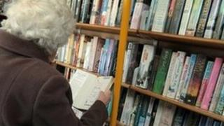 Elderly resident using a mobile library - generic