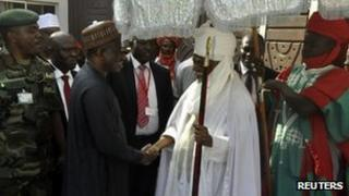 Emir of Kano Ado Bayero (R) welcomes President Goodluck Jonathan during his visit to the northern city of Kano January 22, 2012, following bomb attacks that took place on Friday. Gun and bomb attacks by Islamist insurgents in the northern Nigerian city of Kano last week killed at least 178 people, a hospital doctor said on Sunday