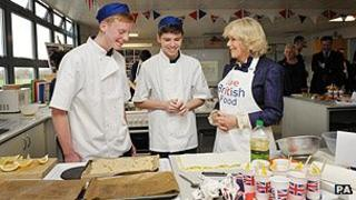 The Duchess of Cornwall meets students cooking at a school in Swindon