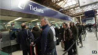People queuing for train tickets at Victoria
