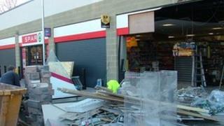 Supermarket's smashed wall