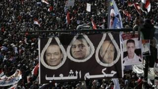 """Banner reading """"Rule of the People"""" at a demonstration in Tahrir Square (25 January 2012)"""