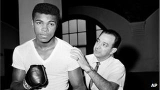 A young Muhammad Ali is seen with his trainer Angelo Dundee in 1962