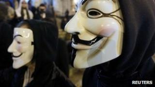 People wearing masks associated with Anonymous (file image)