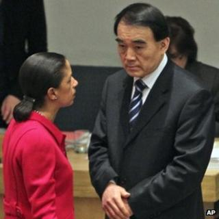 The US envoy to the UN, Susan Rice, talks to her Chinese counterpart Li Baodong