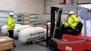 Forklift truck loading wind turbine