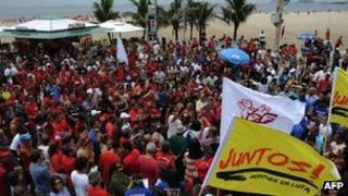 Police and firefighters rally on Copacabana beach on 12 February