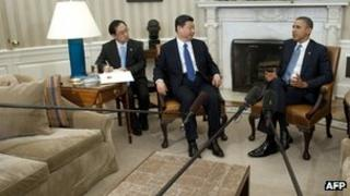 US President Barack Obama and Chinese Vice President Xi Jinping speak during meetings in the Oval Office Washington, DC, 14 February 2012
