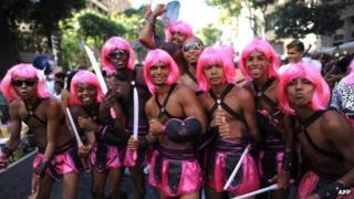 Revellers celebrate carnival at a Rio parade
